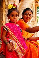 Indian girl with mother at temple