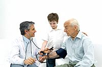 Doctor measuring senior man´s blood pressure, boy helping