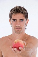 attractive man with an apple in hand