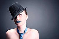 Woman with rhinestones on her lips wearing hat and necktie (thumbnail)