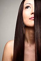 Young woman with long straight hair posing for the camera (thumbnail)