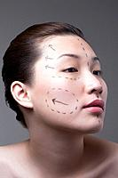 Woman with cosmetic surgery markings on her face