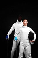 Man and woman in fencing suits posing for the camera