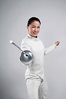 Woman in fencing suit posing for the camera