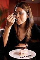 Woman eating a strawberry cake (thumbnail)