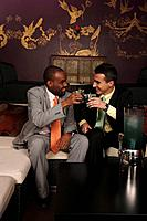 Businessmen toasting drinks