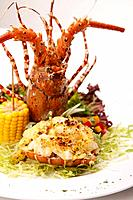 Main course of lobster, corn on cob and side salad (thumbnail)