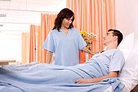 Woman visiting man at his ward