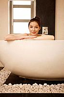Smiling woman in the bathtub
