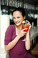 Woman holding a glass of cocktail