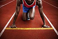 Man in starting position on running track