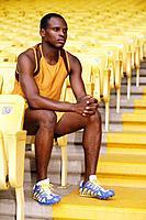 Man on yellow stadium seat