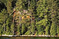 View of lake Sacacomie and house, Quebec, Canada