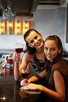 Women having wine at the bar counter