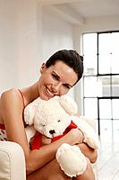Woman hugging a soft toy