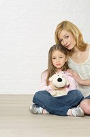 Mother and daughter sitting on floor (thumbnail)