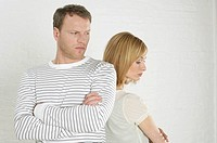 Frustrated couple standing back to back