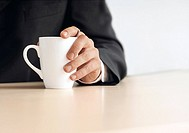 Businessman holding a cup of coffee