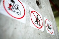Prohibition signs on a concrete wall