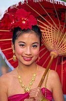 Portrait of a young woman in traditional Thai costume at a traditional festival, Chiang Mai Flower Festival, Chiang Mai, Chiang Mai Province, Thailand