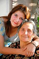 A young woman with her grandmother. Armenia.