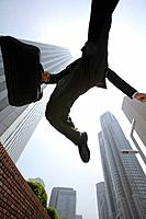 Businessman jumping happily