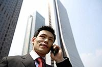 Businessman conversing on a cellphone, portrait