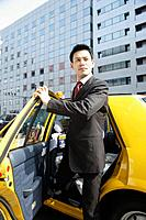 Businessman stepping out of a car