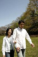 A young couple walking in garden