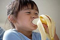 A girl eating banana