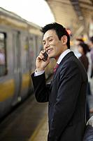 Businessman conversing on his cellphone, portrait