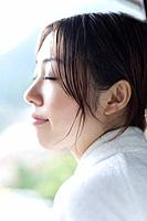 Profile of a woman in bathrobe, closing eyes, side view, Japan