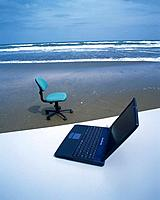 Image of a Laptop and an Office Chair at the Beach, High Angle View