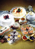 served sweet plate with cakes and pies
