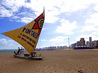 a boat raft anchored at fortaleza beach shore