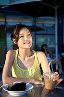 Young Lady Sitting at Outdoor Cafe, Looking Away (thumbnail)
