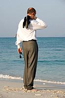 Asia, Thailand, Businessman standing at beach, rear view