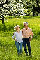 Germany, Baden Württemberg, Tübingen, Senior couple walking across field