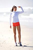 Young woman on beach looking out, portrait
