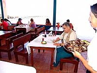 people eating in a restaurant at santa catarina