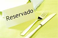 a reserved table with fork and knife