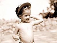 one blond boy wearing a cap