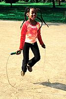 a black girl jumping rope play