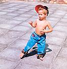 one blond boy dancing barefoot