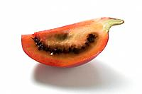A wedge of tamarillo