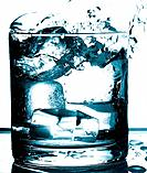 a glass of cold water and ice cubes