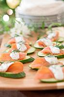 Cucumber slices with smoked salmon & dill cream Christmas