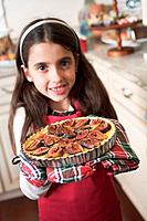 Girl holding freshly_baked fig tart