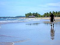 a person walking at bahia beach shore