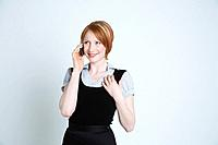 Studio shot of businesswoman talking on mobile phone